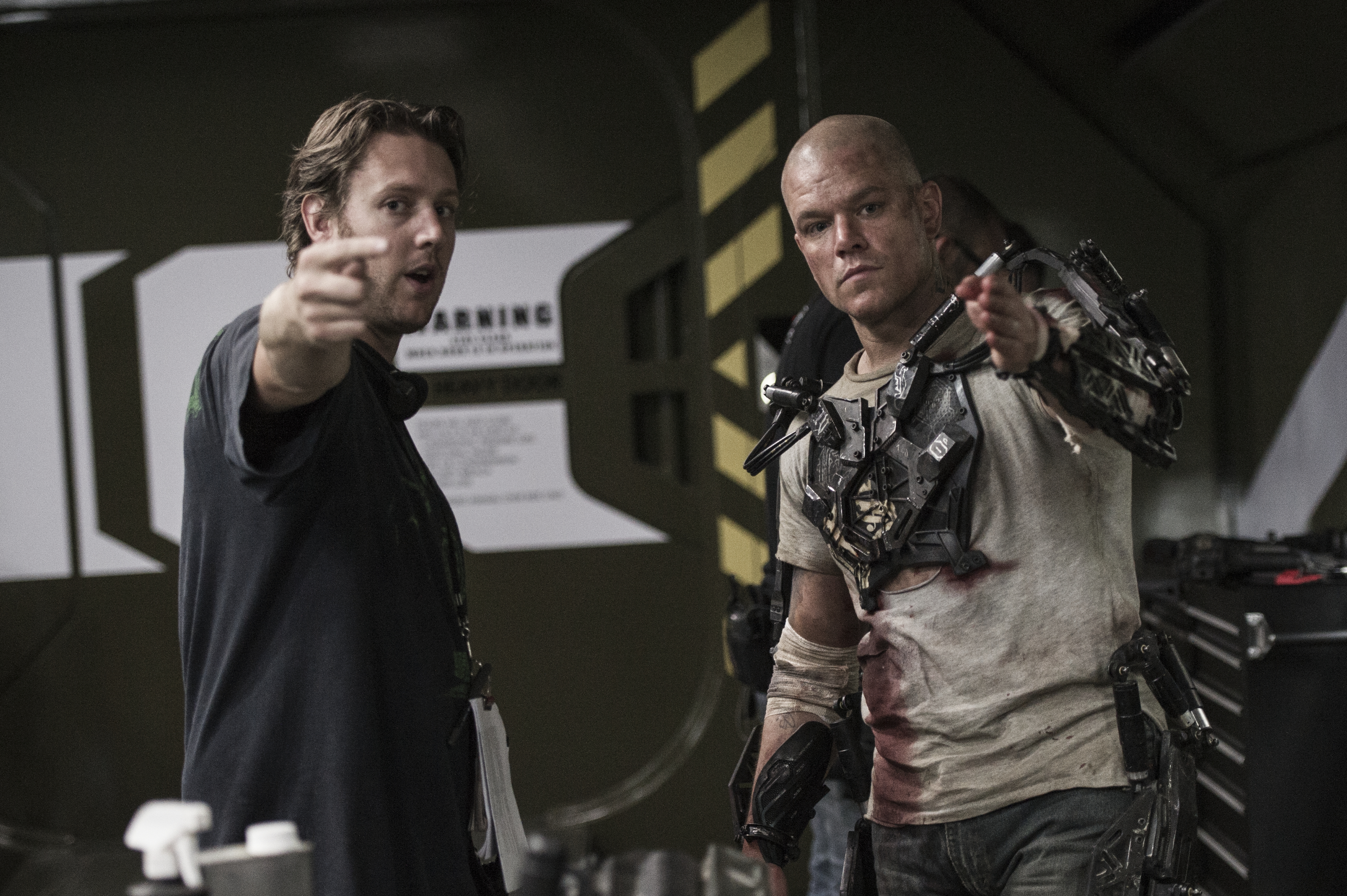 """a review of the film elysium by neil blomkamp But blomkamp seems fully at ease and in control from the earliest scenes of """"elysium,"""" which introduce us to a futuristic los angeles (circa 2154) that has, in one of the film's canniest ."""