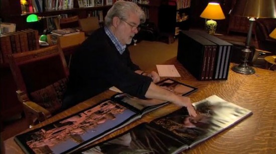 George Lucas looking at Star Wars Frames books