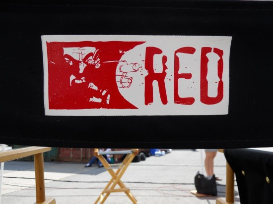 Red logo on chair