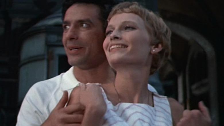 John Cassavettes and Mia Farrow smile