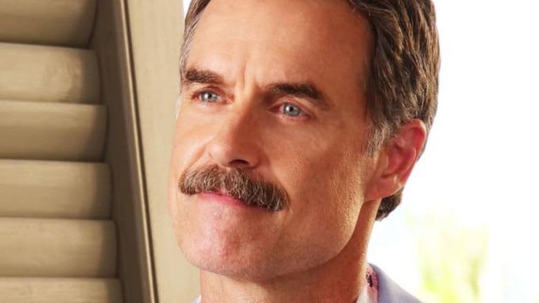 Armond White Lotus moustache