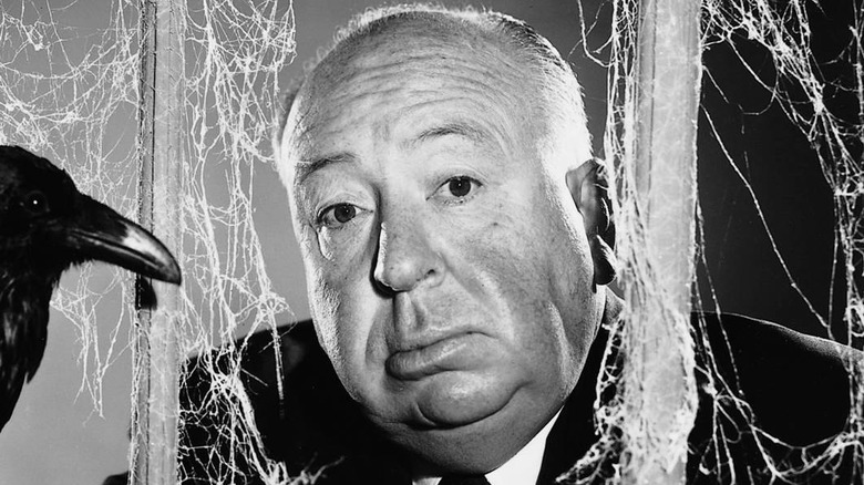 Alfred Hitchcock poses with bird