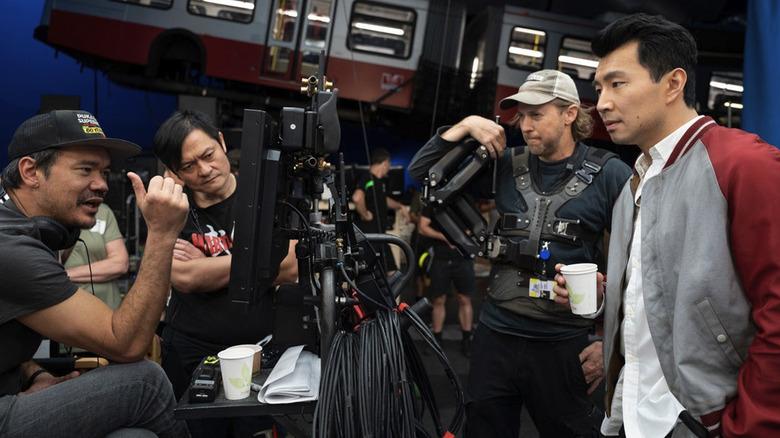 Destin Daniel Cretton and Simu Liu on the set of Shang-Chi