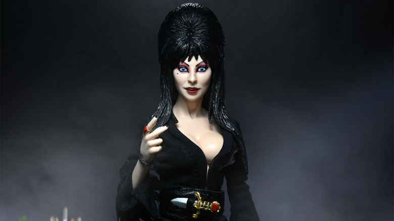 Elvira s 40th Keeps Getting Better With A New NECA Figure Of The Mistress Herself