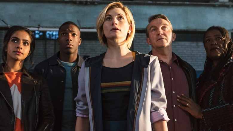 Doctor and companions staring