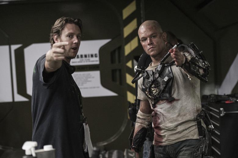 Neil Blomkamp and Matt Damon on Elysium set