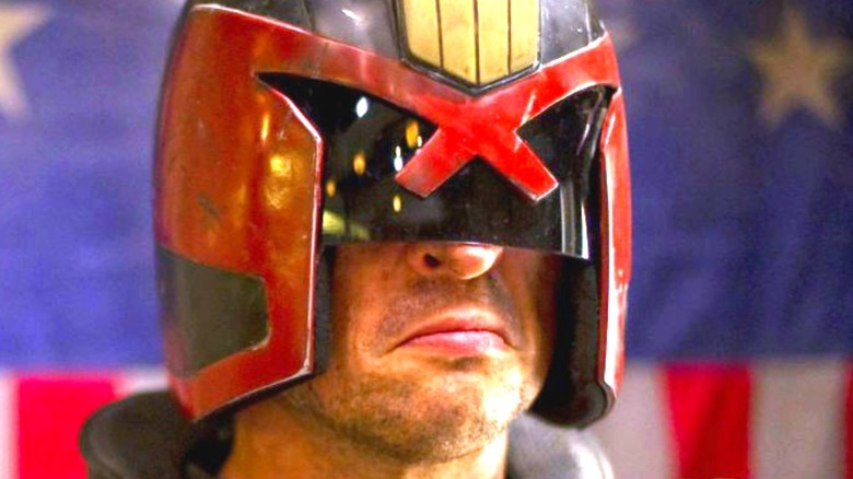 Dredd scowling in helmet