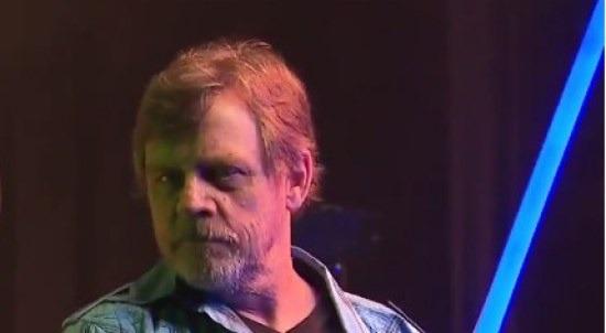 bearded mark hamill with lightsaber from disneyworld video