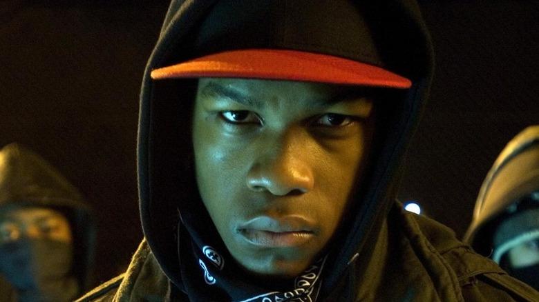 John Boyega staring into a camera lens from Attack the Block