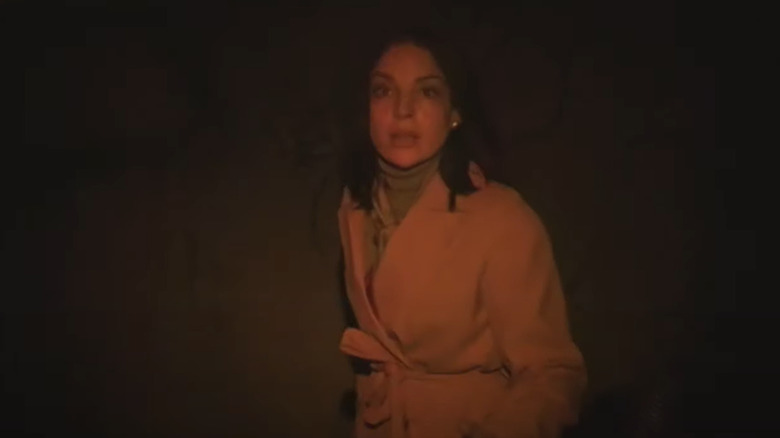 Grainy shot of reporter in dim light