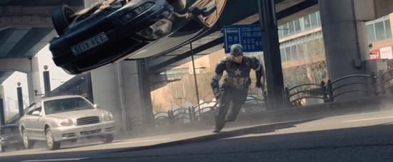 Avengers: Age of Ultron: Captain America runs as cars flip
