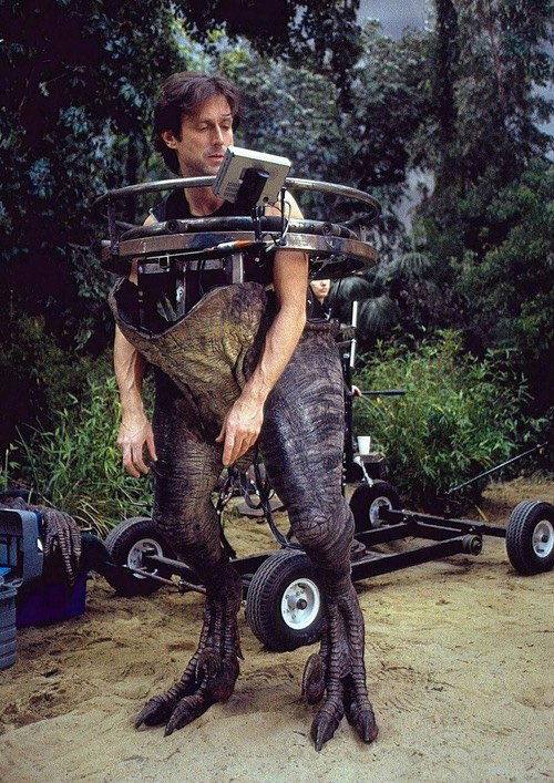effects artist John Rosengrant working in a raptor half-suit for Jurassic Park III.