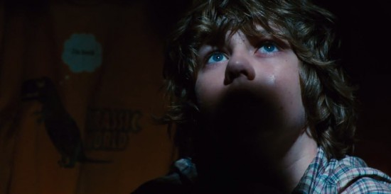 Gray (Ty Simpkins) hiding out in one of the Jurassic World gift shops.