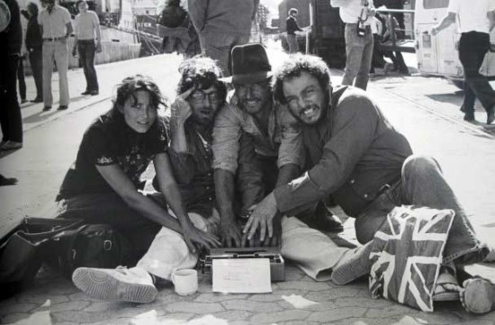 Vintage set photo: Karen Allen, Steven Spielberg, Harrison Ford and John Rhys-Davies working on rewrites of the script on the set of Raiders of the Lost Ark.