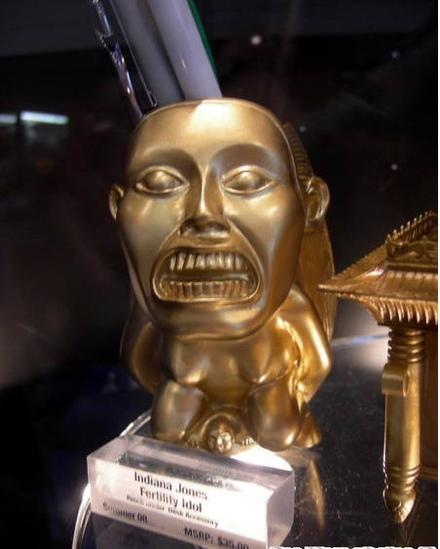 golden fertility idol pen holder